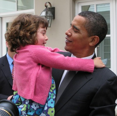 President Obama with little girl, photo by Jurvetson, Flickr.com