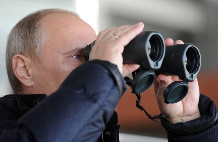 Putin watching Sarah and Todd Palin.
